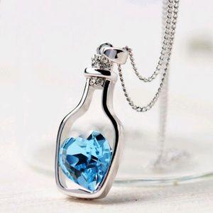 Jewelry - NWT Wine Lover's Blue Heart In Bottle Necklace